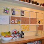 cool cork boards decorated with photograph and notes on white wall plus long wooden table and ceramic plus wall mounted shelf