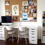 cool cork boards for home office with photographs and white desks with drawers and comfy chairs plus dark wooden flooring