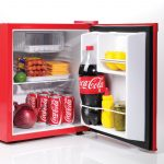 cool red built-in mini fridge for food and drinks sausages chesee coke big onion fresh lemons