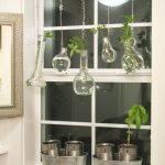 creative and inspiring garden windows for kitchens with hanging greenery pots with glass jar and cans as pot