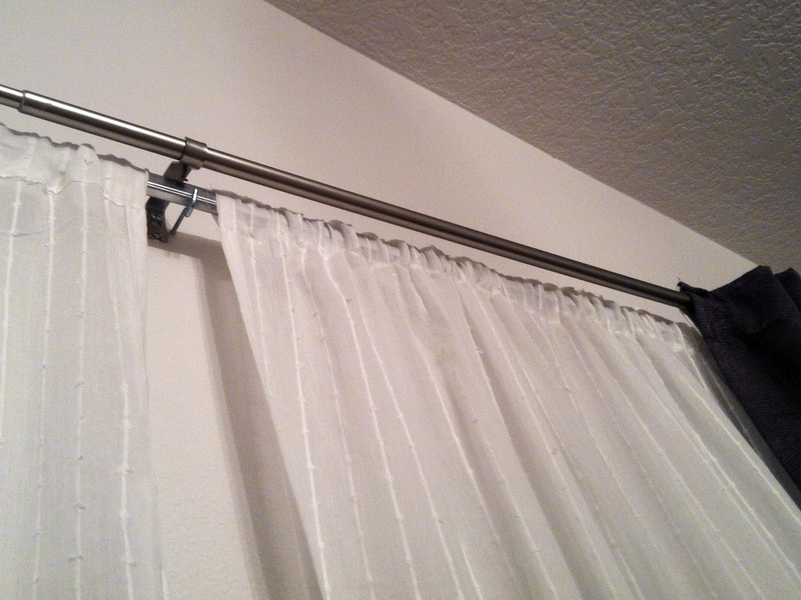 curtain rod white wall ceiling