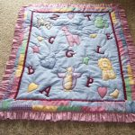 Cute Adorable Baby Quilt To Make Design In Blue Color With Letter Pattern And Hairy Texture On The Edge