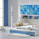 cute blue and white trundle beds for children with twin beds and fun bedding set and shelving  plus rug