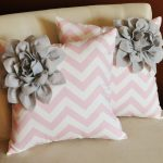 cute light pink pillow design with chevron pattern and gray flower combination on creamy chair