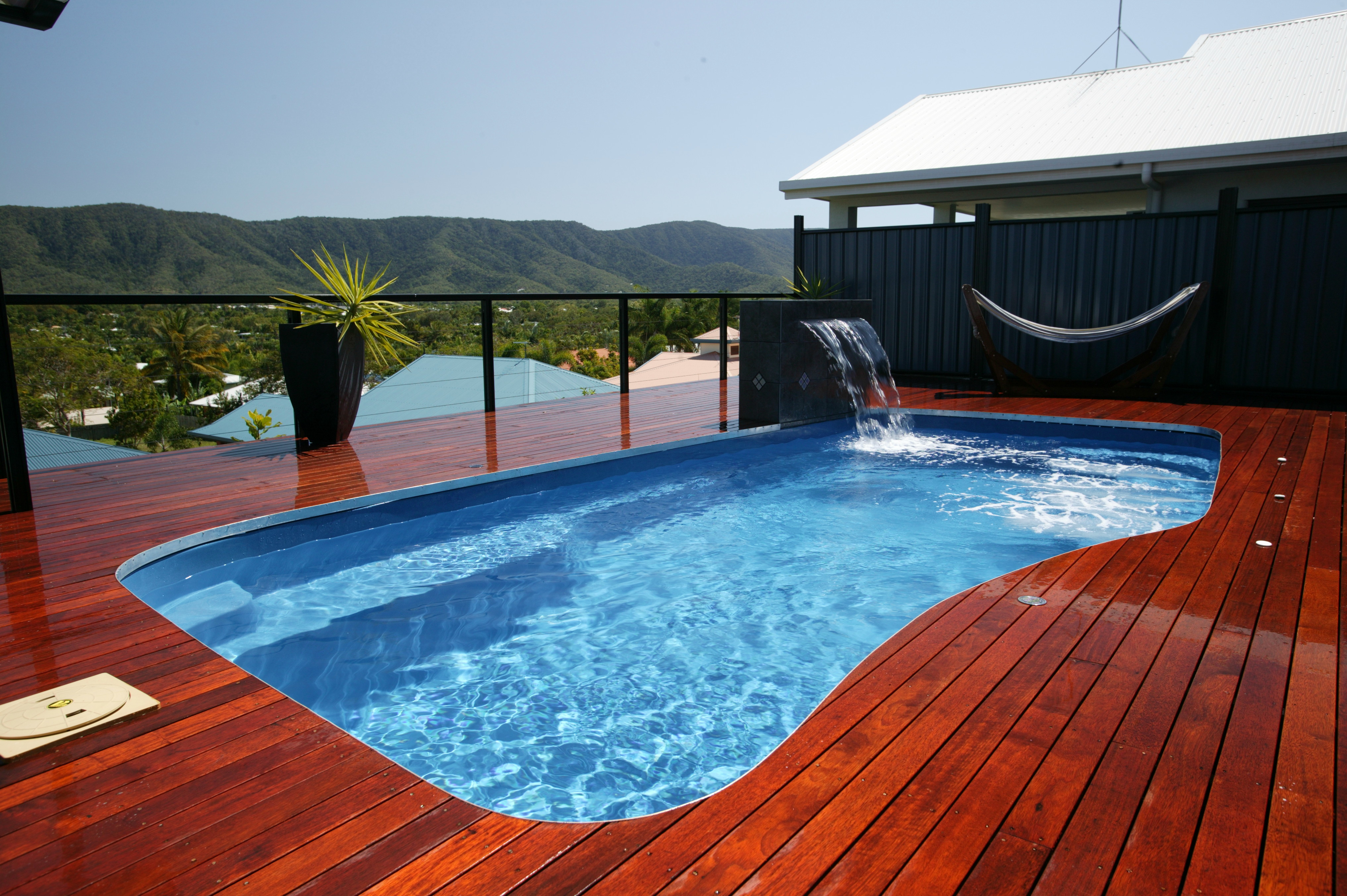 Swimming pool design for your beautiful yard homesfeed for House design with swimming pool