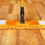 deep cleaning hardwood floors by mopping to obtain shiny floor surface