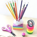 diy colored pencil holder idea in the shape of rainbow cake with geometrical accent for colorful pencils