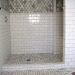 doorless walk in shower with ceramic marble subway tile shower combined with bathroom tile for wall