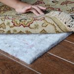 dull white best rug pad for hardwood floor idea with creamy area rug with floral pattern