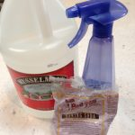 easy natural homemade white vinegar baking soda cleaser spray to get rid of pet odor blue spray bottle