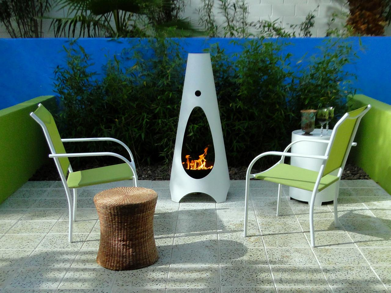 Wonderful Elegant And Minimalist White Chiminea Fire Pit Design On Patio With Green  Chairs And Garden And