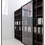 elegant black white bookcase with glass door idea in spacious room with white wall