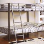 elegant gray bunk bed for small space design with gray white bedding set on wooden floor with metal stairs beneath white wall