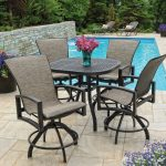 elegant gray chair design with armrest and backrest and round frame and rectangle coffee table aside pool with tiles patio