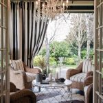 elegant indoor outdoor curtains for porch in striped accentwith comfy chair with striped accent and enlightened with chandeliers and round coffee table