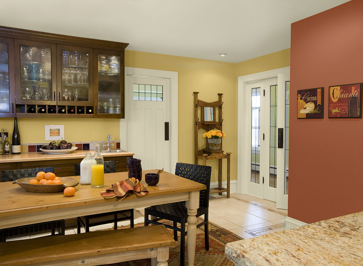 Elegant Paint Color For Kitchen In Yellow And Peach Combination With Rectangle Wooden Table Bench