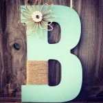 elegant retro large decorative letters design in B shape with diy flower design and traditional rope on wooden wall in soft blue tone