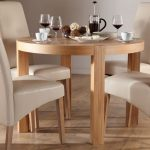 elegant white dining room idea with wooden round kitchen table set for 4 with white chairs with tall backrest in white room with storage