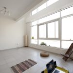 empty room large windows white wall and tiles
