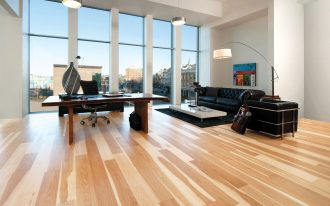 engineered hardwood flooring pros and cons for home office with wooden desk and black classy swivel chair plus black leather sofa