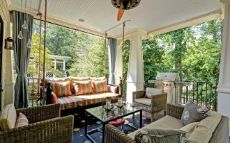 enjoyable porch beautified with indoor outdoor curtains with stunning striped sofa and rectangular coffee table with glass top plus blue rug area