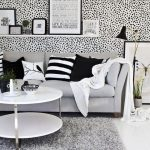fashionable leopard patterned peel and stick removable wallpaper idea with wall rack and gray sofa and black white cushions and round coffee table on concrete floor