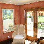faux finish walls wood grain door big window grin chair