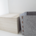 felt storage bin in grey color scheme decorated with wooden boxes