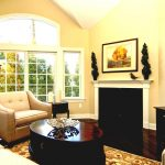 fireplace sofas table rug plant pic windows