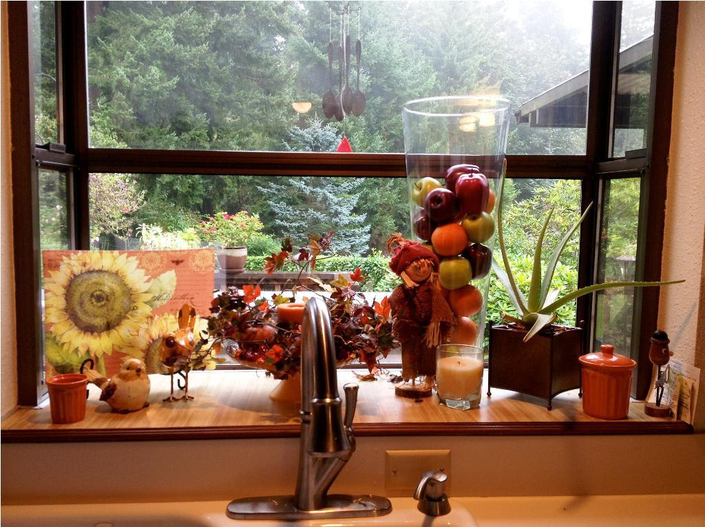 garden windows for kitchens with impressive autumn theme beautified with fresh fruits and candles and others - Garden Window Ideas
