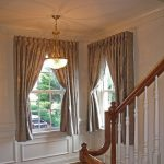 gold tone curtains for casement windows with white walls and elegant gold ceiling lamp and wooden floor