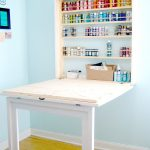 gorgeous fold down laundry table with storage and glass beam on wooden floor and blue wall