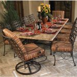 Great Round Wrought Iron Kitchen Table For Dining Space With Marble Top And Striped Motif On Chairs Plus Table Runner And Flower Vase Plus Candle As Centerpiece