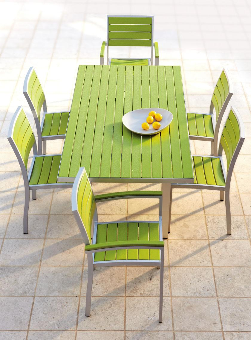 green target patio chairs with green wooden table plus tile flooring