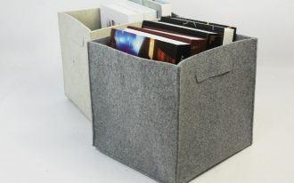 grey and white felt storage bin for home storage containing books