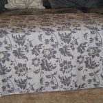 grey and white patterned ottoman slip covers decotated in front of sofa for living room ideas