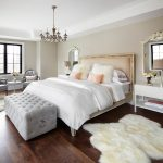 Grey Foam Storage Benches For End Of Bed For Modern Elegant Bedroom With Soft Ivory Fur Rug Fur Cushion Beige Walls Antique Ceiling Lamp Grey Foam Chairs