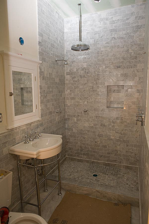 Marble subway tile shower offering the sense of elegance for Modern subway tile bathroom designs