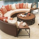 half round bamboo Thomasville outdoor furniture pop colors cushions natural wooden round table natural porcelaine floor backyard swimming pool