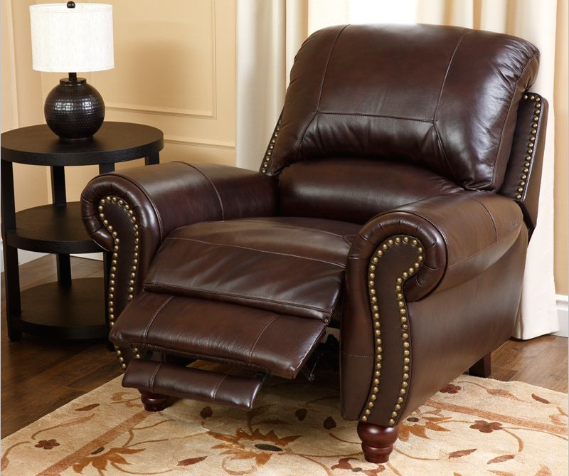 high end recliners designed in a very comfortable way with footstool and comfy back plus arm and wooden short leg plus brown rug with round end table