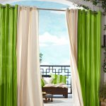 indoor outdoor curtains for gazebo with green and ivory scheme decorated with wooden chair with striped cushion and short coffee table plus greenery