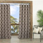 indoor outdoor curtains with white and brown patterned curtain panel plus metal chair with comfy cushion and tile flooring plus greenery