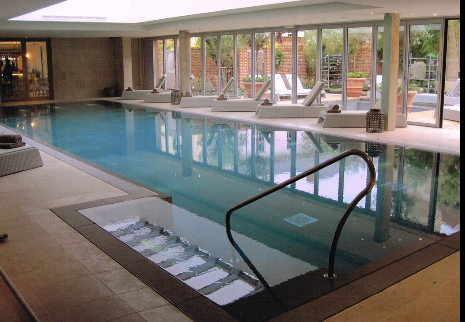 Cheap Indoor Pool Ideas fully enclosed pool with attached spa Indoor Swimming Pool