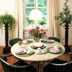 inspiring centerpieces for dining room tables in a round table with marble top plus green chairs beautified with flower vase and pinky candles