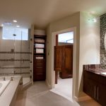 interior decorator Houston Eklektik Interiors for modern clean bathroom with two tone tile walls frameless glass shower