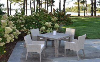 kingsley bate sag harbor decorated with wooden table and beautiful garden surrond