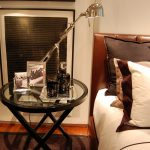 lamp table pillows bed