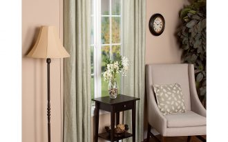 lamp window curtains chair pillow table vase clock