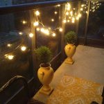 lamps lights string balcony vases plants chair rug