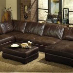 large brown leather sectional sofa sleepers wooden living room floor beige rug